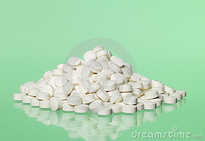 Pills toward green background