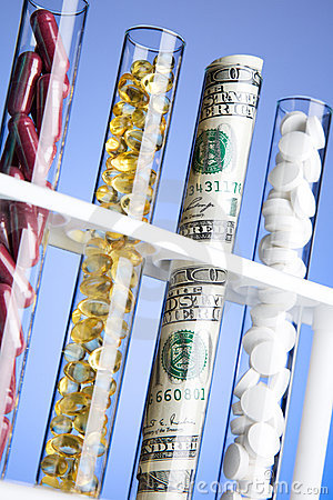 Pills, vitamins and money in test tubes