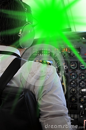 Free Pilot Blinded From A Laserpointer Royalty Free Stock Image - 55774336