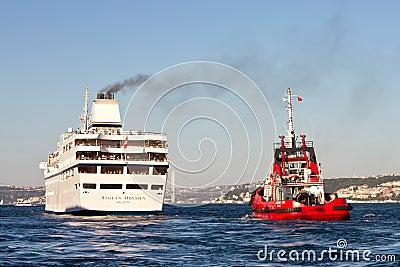 Pilot boat monitors luxury ship Editorial Photography