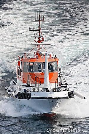 Clipping Norwegian pilot boat in sea, Scandinavia