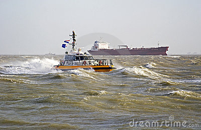 A pilot boat in the storm