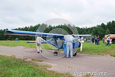 Pilot checks engine of Aeroprakt-22L plane Editorial Stock Photo