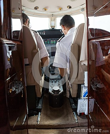 Pilot And Copilot Operating Private Jet