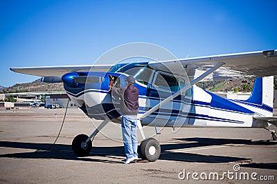 Pilot doing preflight of light aircraft