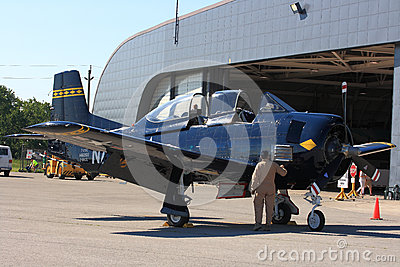 Pilot executes Preflight inspection of North American T-28 Trojan ? Hamilton SkyFest 2014 Editorial Photography