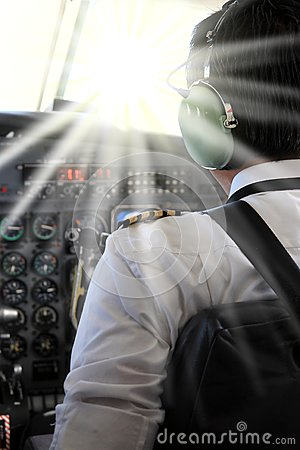 Free Pilot In Cockpit Blinded By A Laser Pointer Stock Image - 87774141