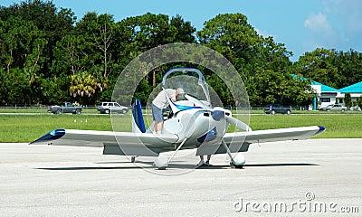 pilot making preflight checks
