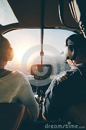 Free Pilots Flying A Helicopter On Sunny Day Stock Photography - 68244822
