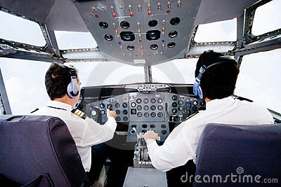 Pilots flying an airplane