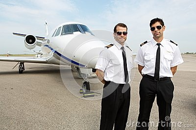 Pilots Standing In Front Of Private Jet