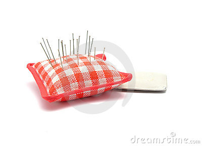Pin cushion with pins and chalk