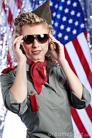 Pin-up army woman  standing near the American flag