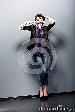 Pin Up Fashion Girl posing in Studio. Glamor