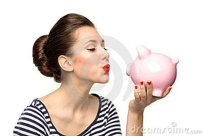 Pin-up girl kissing piggybank