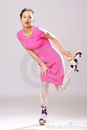 Pin-up girl in pink dress