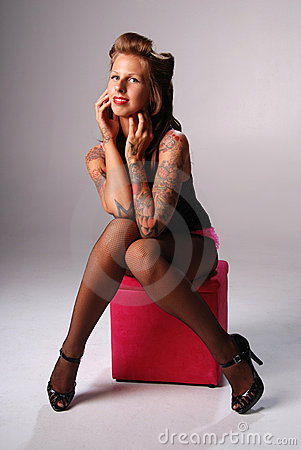 Pin-up girl with tattoos.