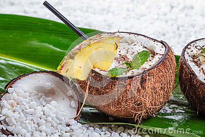 Pinacolada drink with chocolate in coconut