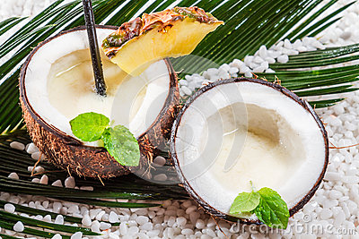 Pinacolada drink with milk in the fresh coconut
