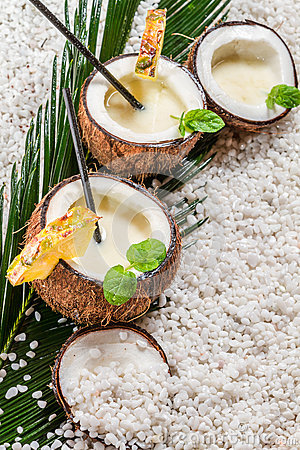 Pinacolada drink served in a coconut on the beach