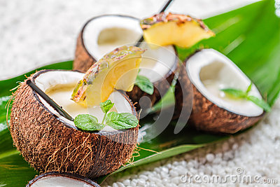 Pinacolada with fresh mint leaves served in coconut