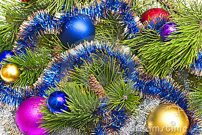 Pine branch with Christmas decorations