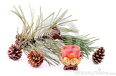 Pine branch with cone and candle
