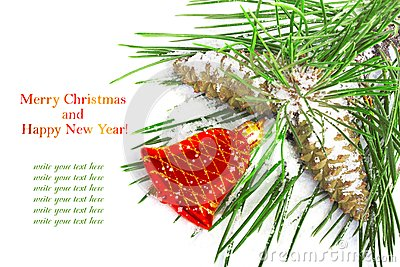 Pine branch with cones and red Christmas bell