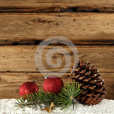 Pine cone and red baubles