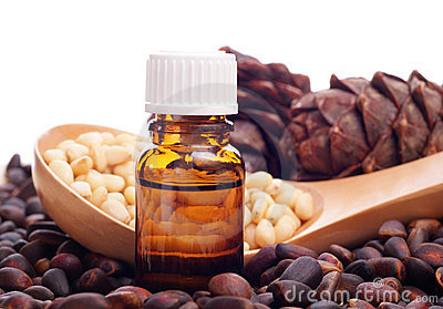 Pine nuts and bottle of essential oil