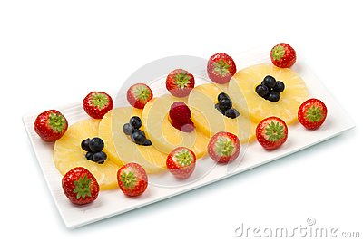 Pineapple slices with berries