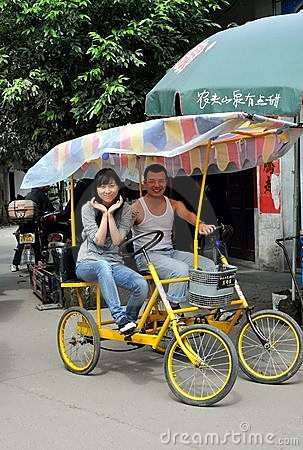 Ping Le, China: Young Couple in Double Bicycle Editorial Stock Photo