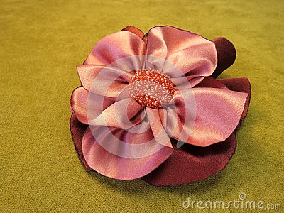 Pink artificial fabric flower