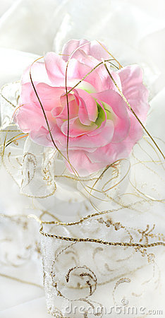 Pink artificial rose on white