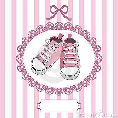 Pink baby shoes and lace frame
