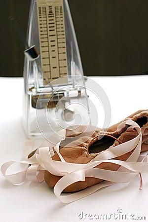 Pink ballet shoes, metronome