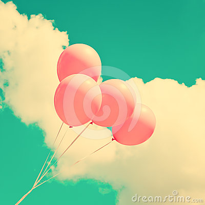 Pink balloons in sky