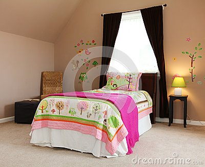 Pink bed in kids baby girl bedroom interior.