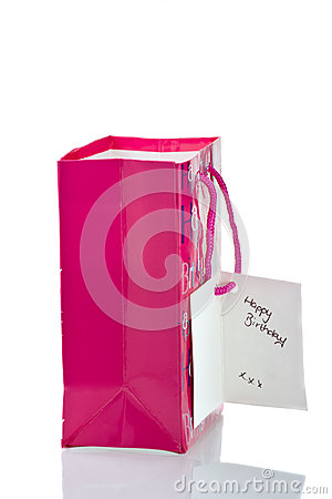 Pink birthday gift bag isolated on white
