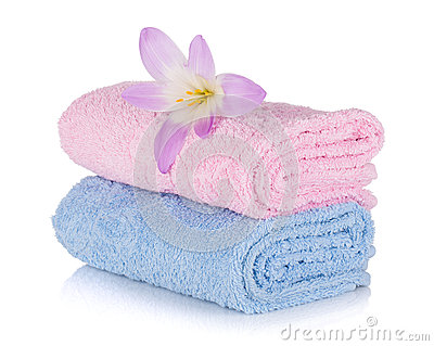 Pink and blue towels and flower