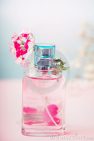 Free Pink Bottle Of Floral Perfume With Flowers, Natural Cosmetic Product Or Beauty Concept On Pastel Background Royalty Free Stock Photo - 95759435
