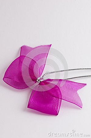 Pink bow tie ribbon with silver cord