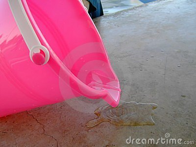 Pink bucket spilling water for summer
