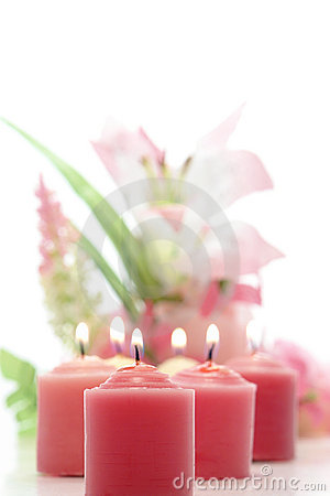 Pink Candles Burning and Pastel Floral Arrangement