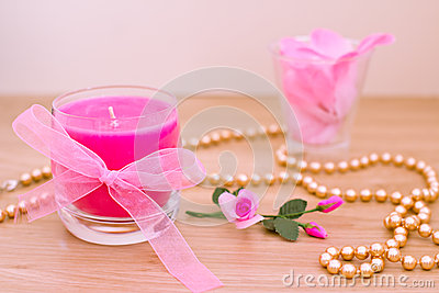 Pink candles and petals for aromatherapy