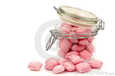 Pink candy in a glass jar
