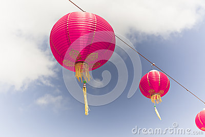 Pink Chinese Paper Lanterns against a Blue Sky