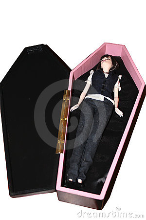 A pink coffin with a doll.