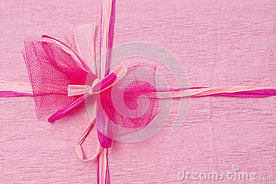 Pink color gift box with ribbon