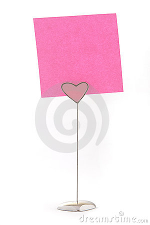 Pink color notes on a heart shape holder
